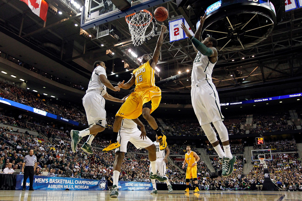 . Erik Buggs #15 of the Valparaiso Crusaders drives for a shot attempt in the first half against Branden Dawson #22 of the Michigan State Spartans during the second round of the 2013 NCAA Men\'s Basketball Tournament at at The Palace of Auburn Hills on March 21, 2013 in Auburn Hills, Michigan.  (Photo by Gregory Shamus/Getty Images)