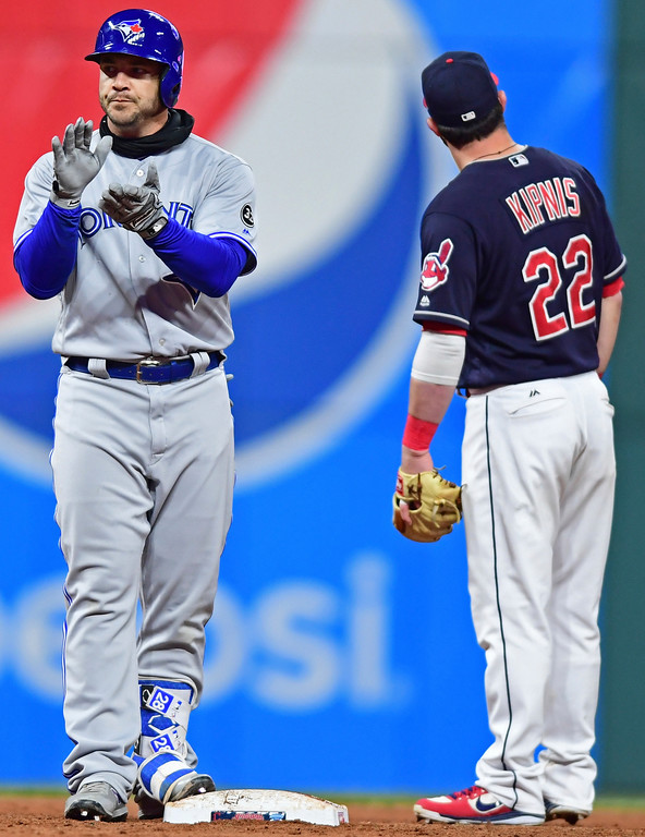. Toronto Blue Jays\' Steve Pearce celebrates after a two-run double during the ninth inning of a baseball game against the Cleveland Indians, Friday, April 13, 2018, in Cleveland. The Blue Jays won 8-4. (AP Photo/David Dermer)