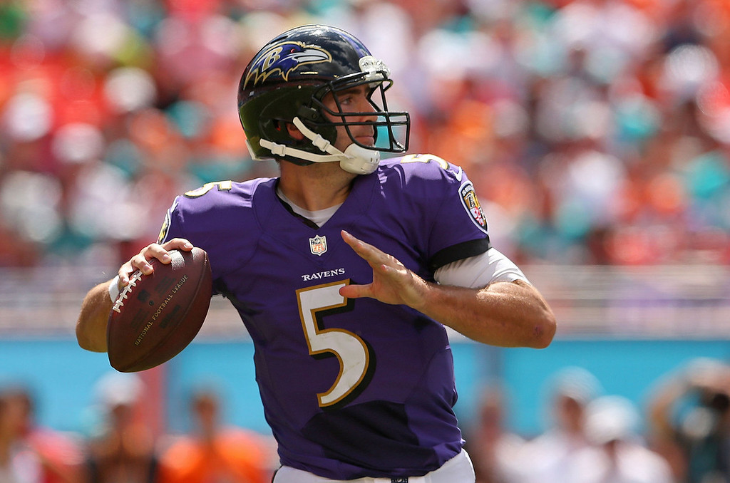 . Joe Flacco #5 of the Baltimore Ravens passes during a game against the Miami Dolphins at Sun Life Stadium on October 6, 2013 in Miami Gardens, Florida.  (Photo by Mike Ehrmann/Getty Images)