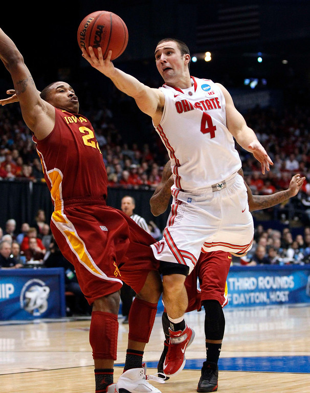. Ohio State Buckeyes guard Aaron Craft (R) goes to the basket past Iowa State Cyclones guard Tyrus McGee (L) during the second half of their third round NCAA tournament basketball game in Dayton, Ohio March 24, 2013. REUTERS/Matt Sullivan