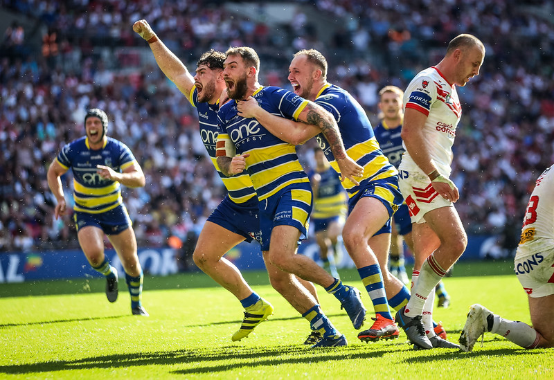 Daryl Clark of Warrington celebrates scoring a a try during the Coral Challenge Cup Final at Wembley Stadium