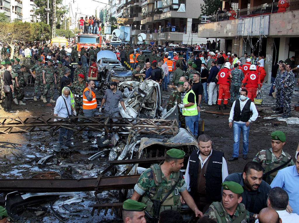 . Lebanese policemen inspect the scene of two suicides explosions near the Iranian embassy in south Beirut, Lebanon, early 19 November 2013. EPA/Nabil Mounzer