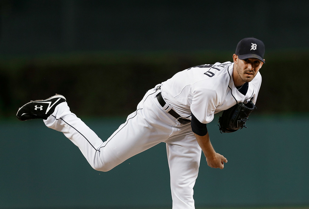. Detroit Tigers pitcher Rick Porcello throws a warmup pitch against the New York Yankees in the first inning of a baseball game in Detroit Tuesday, Aug. 26, 2014. (AP Photo/Paul Sancya)