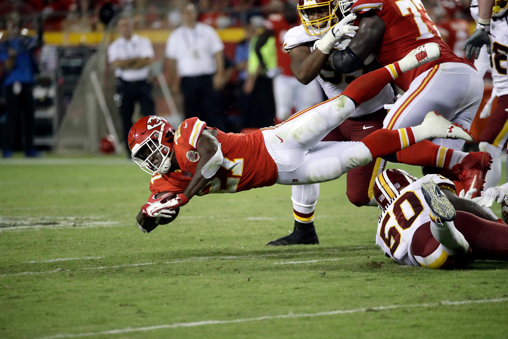 . Kansas City Chiefs running back Kareem Hunt (27) leaps for extra yardage during the second half of an NFL football game against the Washington Redskins in Kansas City, Mo., Monday, Oct. 2, 2017. (AP Photo/Charlie Riedel)