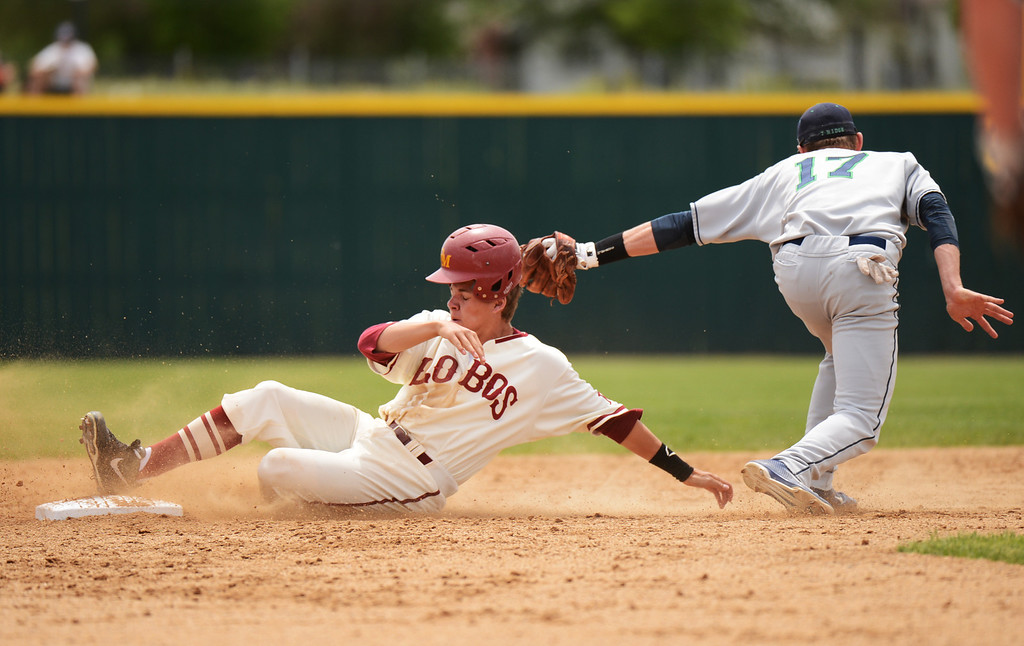 . DENVER, CO. - MAY 25: Cole Anderson of Rocky Mountain HIgh School fail to steal second base from Brody Westmoreland of ThunderRidge High School during the final round of 5A baseball state championship game at All City Field. Denver, Colorado. May 25, 2013. ThunderRidge won 2-1. (Photo By Hyoung Chang/The Denver Post)