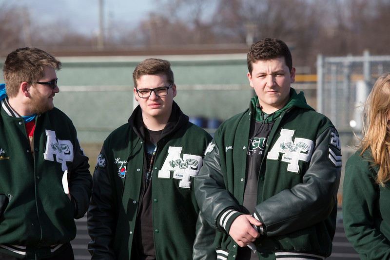 Students at Allen Park High School locked arms on the football field in remembrance of victims of school violence around the country. Michelle Fish – For The News-Herald