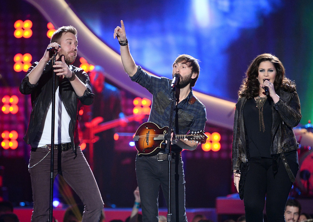 . (L-R) Recording artists Charles Kelley,  Dave Haywood and Hillary Scott of Lady Antebellum perform onstage during the 2013 American Country Awards at the Mandalay Bay Events Center on December 10, 2013 in Las Vegas, Nevada.  (Photo by Ethan Miller/Getty Images)