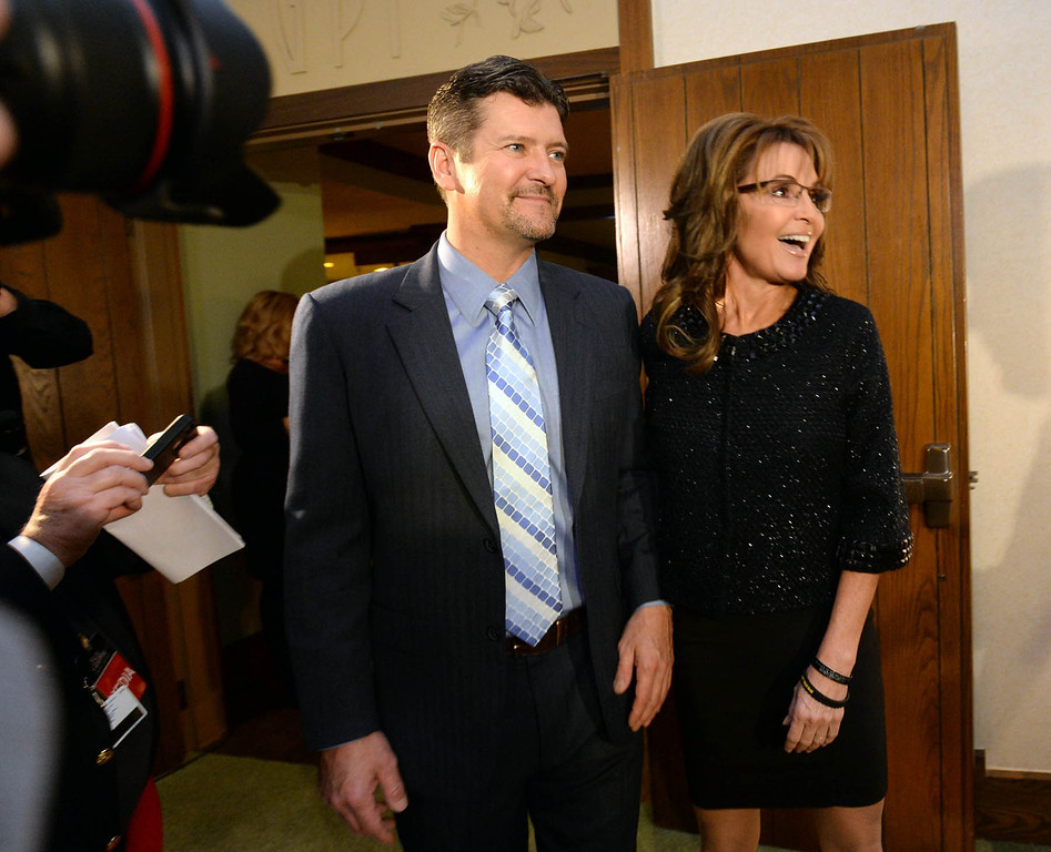 . Former Gov. of Alaska, Sarah Palin and her husband Todd arrive at the Grove Park Inn for a celebration of Billy Graham\'s 95th birthday in Asheville, N.C., Thursday, Nov. 7, 2013.  (AP Photo/The Charlotte Observer, Todd Sumlin)