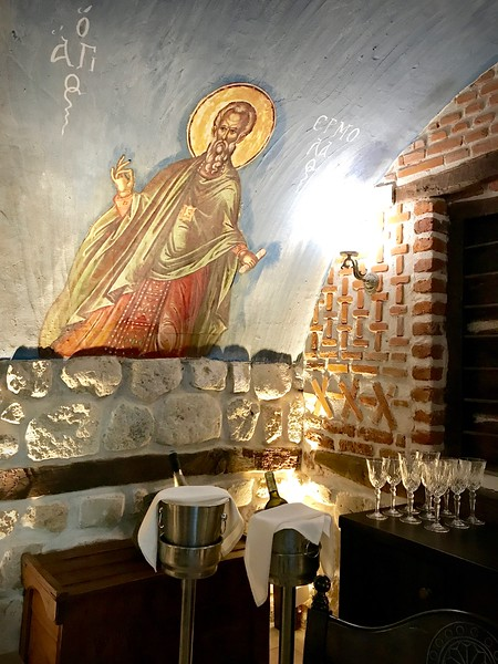 restaurant with painting of saint on the wall