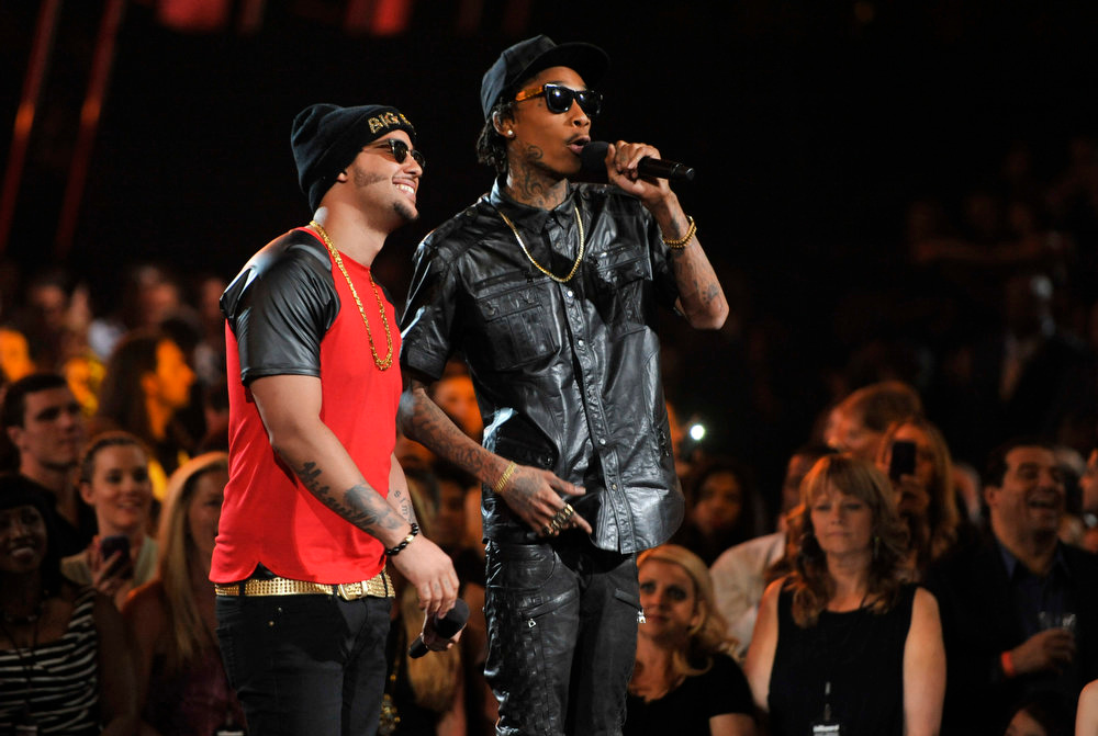 . Wiz Khalifa, right, and Sky Blu speak on stage at the Billboard Music Awards at the MGM Grand Garden Arena on Sunday, May 19, 2013 in Las Vegas. (Photo by Chris Pizzello/Invision/AP)