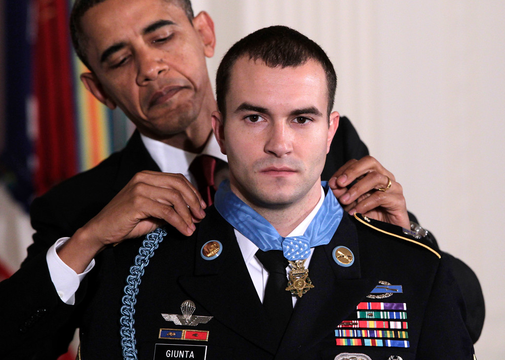 . President Barack Obama presents the Medal of Honor to Staff Sgt. Salvatore Giunta, who rescued two members of his squad in October 2007 while fighting in the war in Afghanistan, Tuesday, Nov. 16, 2010, at the White House in Washington. (AP Photo/J. Scott Applewhite)