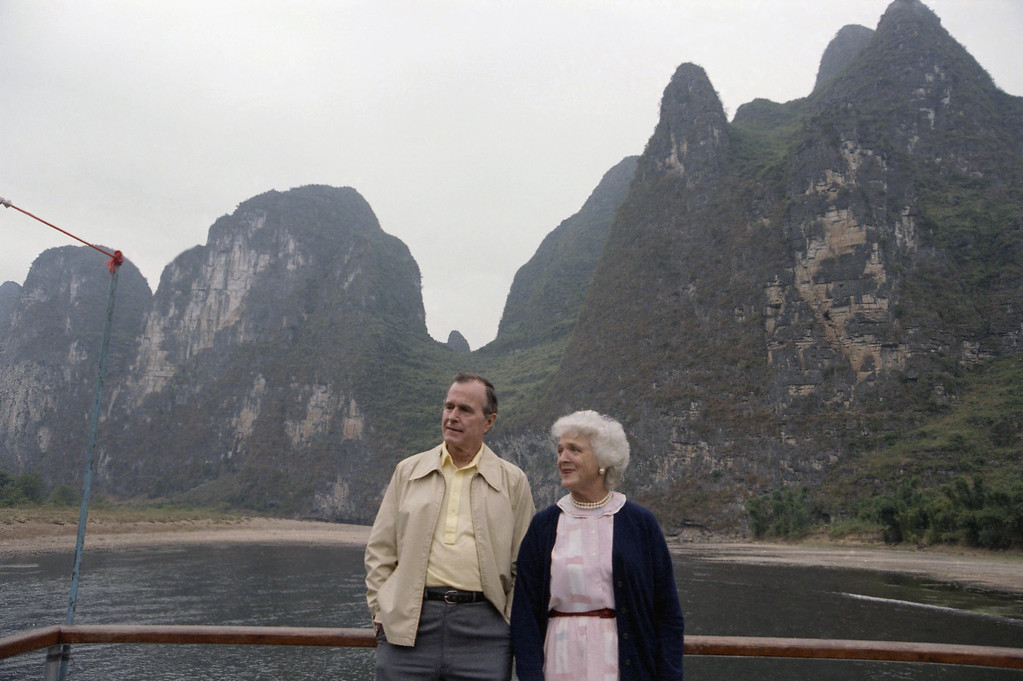 . U.S. Vice-President George H.W. Bush and wife Barbara Bush as they toured the Guilin area, Oct. 13, 1985 in China. (AP Photo/Neal Ulevich)