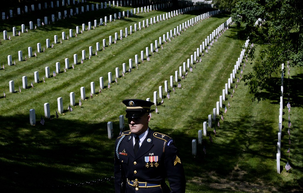 . A member of the honor guard stands as the motorcade carrying U.S. President Barack Obama arrives for a Memorial Day ceremony at Arlington National Cemetery May 25, 2015 in Arlington, Virginia. Obama, Chairman of the Joint Chiefs of Staff U.S. Army General Martin Dempsey and U.S. Defense Secretary Ash Carter honored fallen soldiers at Arlington on this Memorial Day.  (Photo by Olivier Douliery-Pool/Getty Images)