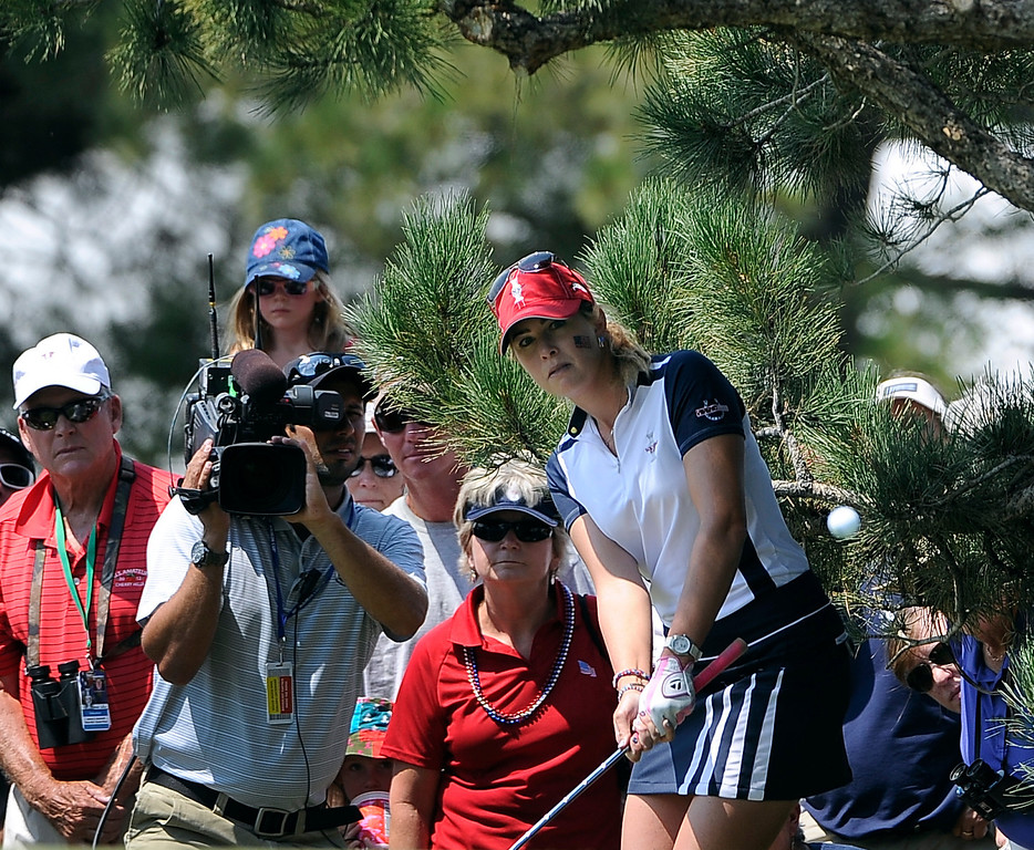 . PARKER, CO - Aug.17: Team USA\'s Paula Creamer hits her ball out from under a patch of trees. The 2013 Solheim Cup takes place at the Colorado Golf Club with the USA taking on Europe in the Saturday morning Foursomes Match. (Photo By Kathryn Scott Osler/The Denver Post)
