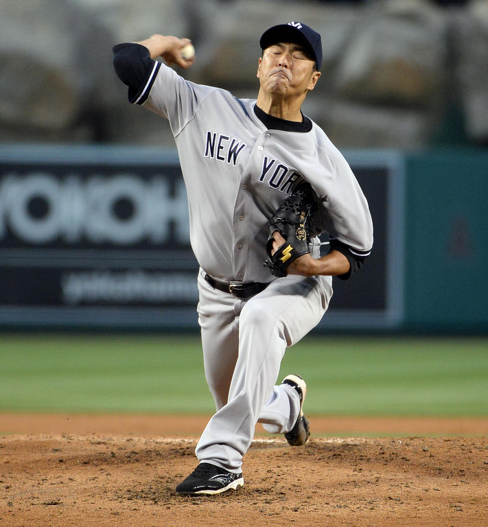 . New York Yankees starting pitcher Hiroki Kuroda throws to the plate against Los Angeles Angels in the second inning of a baseball game at Anaheim Stadium in Anaheim, Calif., on Tuesday, May 6, 2014.  (Keith Birmingham Pasadena Star-News)