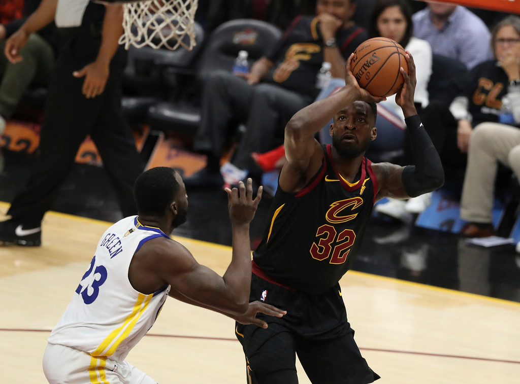 . Cleveland Cavaliers\' Jeff Green (32) shoots over Golden State Warriors\' Draymond Green in the first half of Game 3 of basketball\'s NBA Finals, Wednesday, June 6, 2018, in Cleveland. (AP Photo/Carlos Osorio)