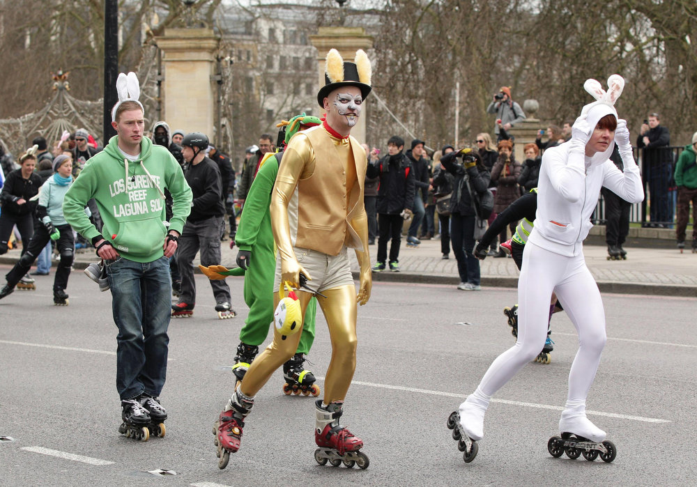 Description of . Skaters dressed in flamboyant rabbit costumes leave their starting point at Hyde Park, during the traditional Easter Bunny Stroll charity event, in central London, Sunday March 31, 2013.  The Easter skate extravaganza attracts some hundreds of skate enthusiasts for a fun event to herald in the summer skating season. (AP Photo/Yui Mok, PA)