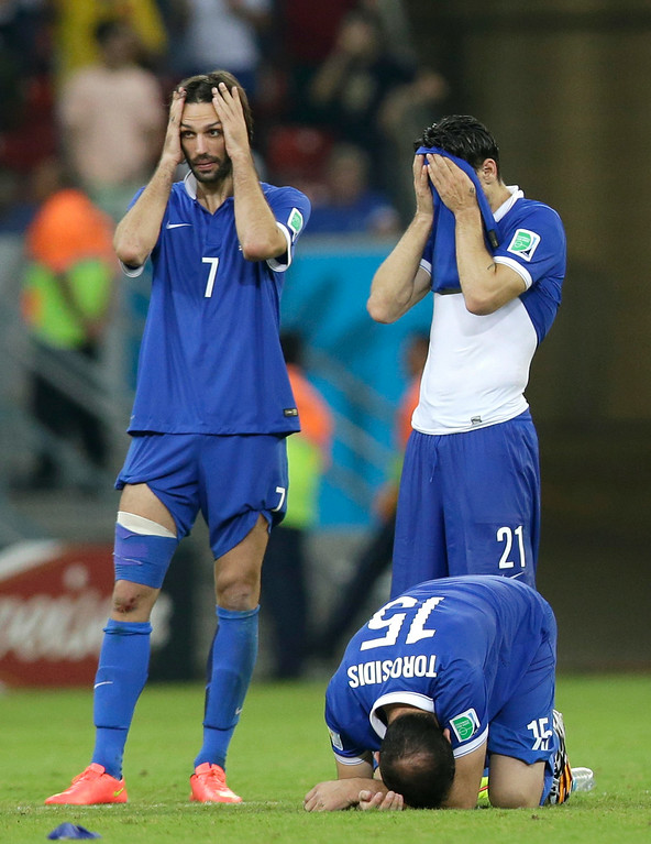 . Greece\'s Giorgos Samaras (7) and teammates react after a penalty shootout at the end of the World Cup round of 16 soccer match between Costa Rica and Greece at the Arena Pernambuco in Recife, Brazil, Sunday, June 29, 2014. Costa Rica won 5-3 on penalties after the match ended 1-1.  (AP Photo/Andrew Medichini)