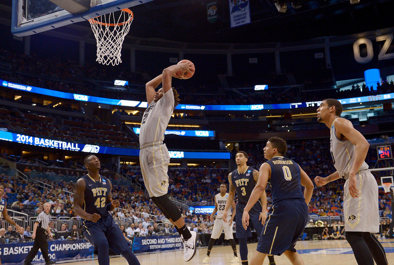 . Colorado forward Xavier Johnson (2) dunks the ball during the second half in a second-round game in the NCAA college basketball tournament Thursday, March 20, 2014, in Orlando, Fla. (AP Photo/Phelan M. Ebenhack)