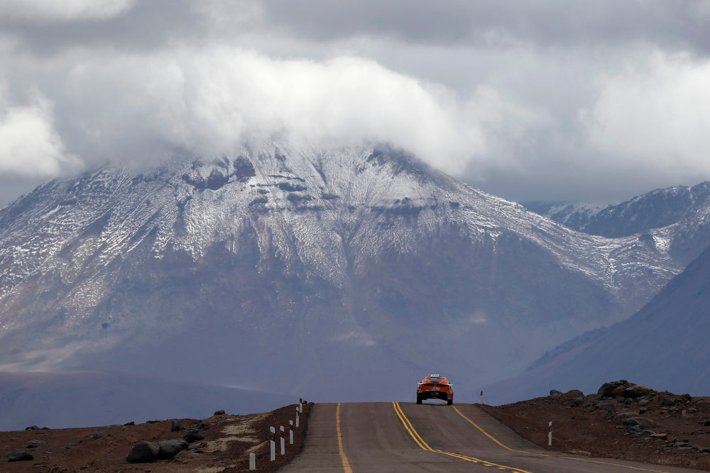 Description of . A car passes the highlands of Chile en route to the Jama border crossing during the untimed 7th stage of the Dakar Rally 2013 from Calama to Salta, January 11, 2013. REUTERS/Ivan Alvarado (CHILE - Tags: SPORT MOTORSPORT)