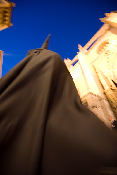 Hooded penitent entering Seville's cathedral, Holy Week 2008, Spain