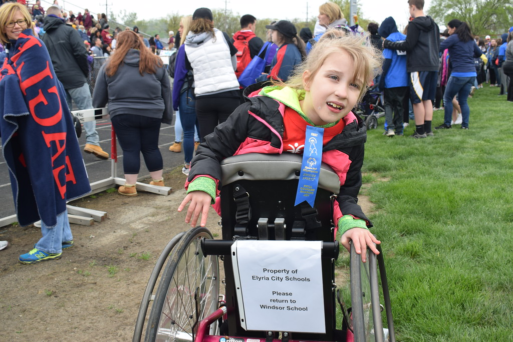 . Briana Contreras � The Morning Journal <br> Destiny Hall, 7, of Windsor Elementary in Elyria wins first place in the 10 Meter Assisted Walk at the 38th Annual Lorain County Special Olympics Track and Field Event held on May 11 at Ely Stadium in Elyria.