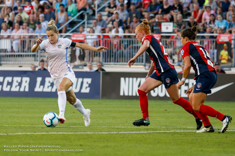 Houston Dash forward Kealia Ohai (7) keeps the ball as Washington Spirit defender Tori Huster (23) and Washington Spirit defender Paige Nielsen (14) track her at Maureen Hendricks Field in Boyds, MD, on July 20, 2019.