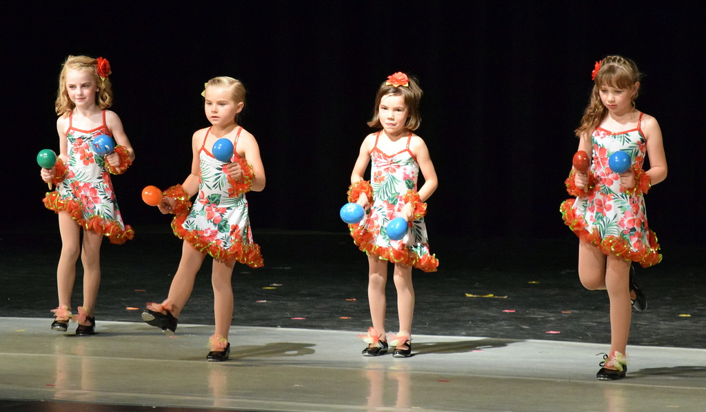 ". Dancers perform to ""Chihuahua\"" at Melissa\'s School of Dance and Gymnastics\' \""Dance In Motion\"" recital Wednesday, June 13, 2018. Front row, Gracie Abrahamson, Ashtyn Fuller, back row, from left; Mariah Perez, Bray Lynne Gower"