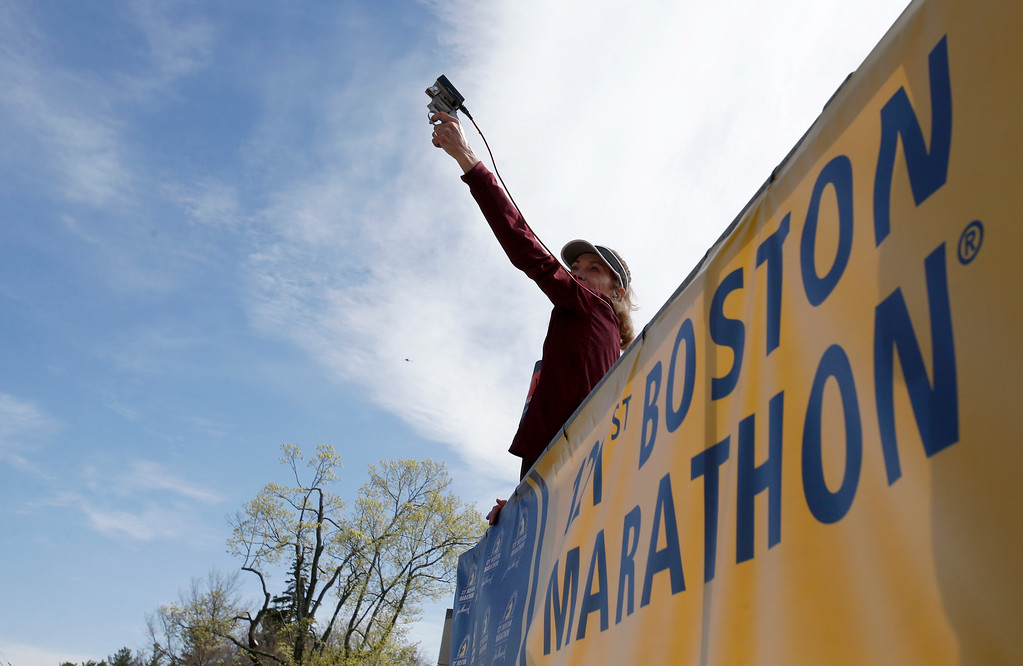 . Kathrine Switzer, who was the first official woman entrant in the Boston Marathon 50 years ago, prepares to fire the gun to start the women\'s elite division at the start of the 2017 Boston Marathon in Hopkinton, Mass., Monday, April 17, 2017. (AP Photo/Mary Schwalm)
