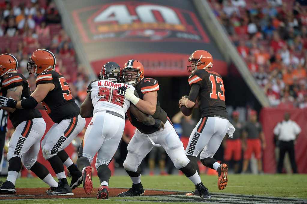 . Cleveland Browns tackle Joe Thomas (73) Tampa Bay Buccaneers defensive tackle Clinton McDonald (98) during the first half of a preseason NFL football game in Tampa, Fla., Saturday, Aug. 29, 2015. (AP Photo/Phelan M. Ebenhack)