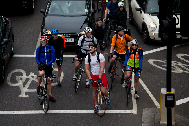 . Cyclists wait for a traffic light to change during a 48 hour workers strike partially closing the London Underground train network in London, Tuesday, April 29, 2014.  Members of the Rail, Maritime and Transport Union are going on strike over management plans to close all ticket offices on the subway network, known as the Tube, which will result in around 750 job losses from the Underground\'s staff of 18,000.  A further 72 hour strike is planned starting May 5.  (AP Photo/Matt Dunham)