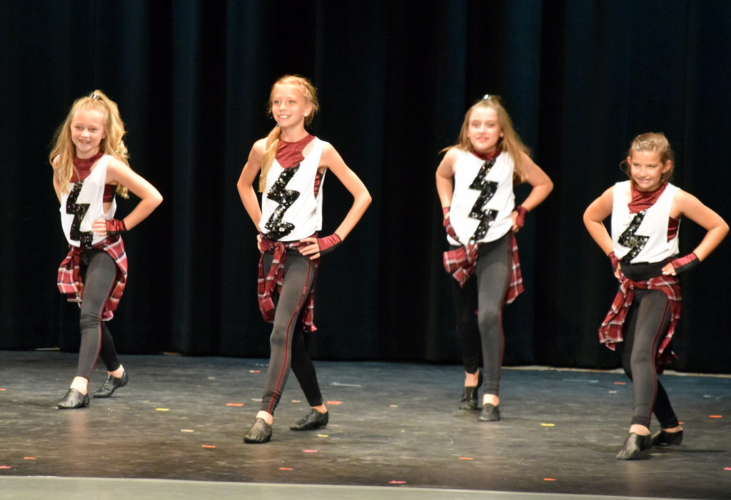 ". Tap dancers perform to ""Pop\"" at Melissa\'s School of Dance and Gymnastics\' \""Dance In Motion\"" recital Wednesday, June 13, 2018. Front row, Ashley Bornhoft, Emma Feather and back row, Renzi Rubottom, left, Hayden Parks."