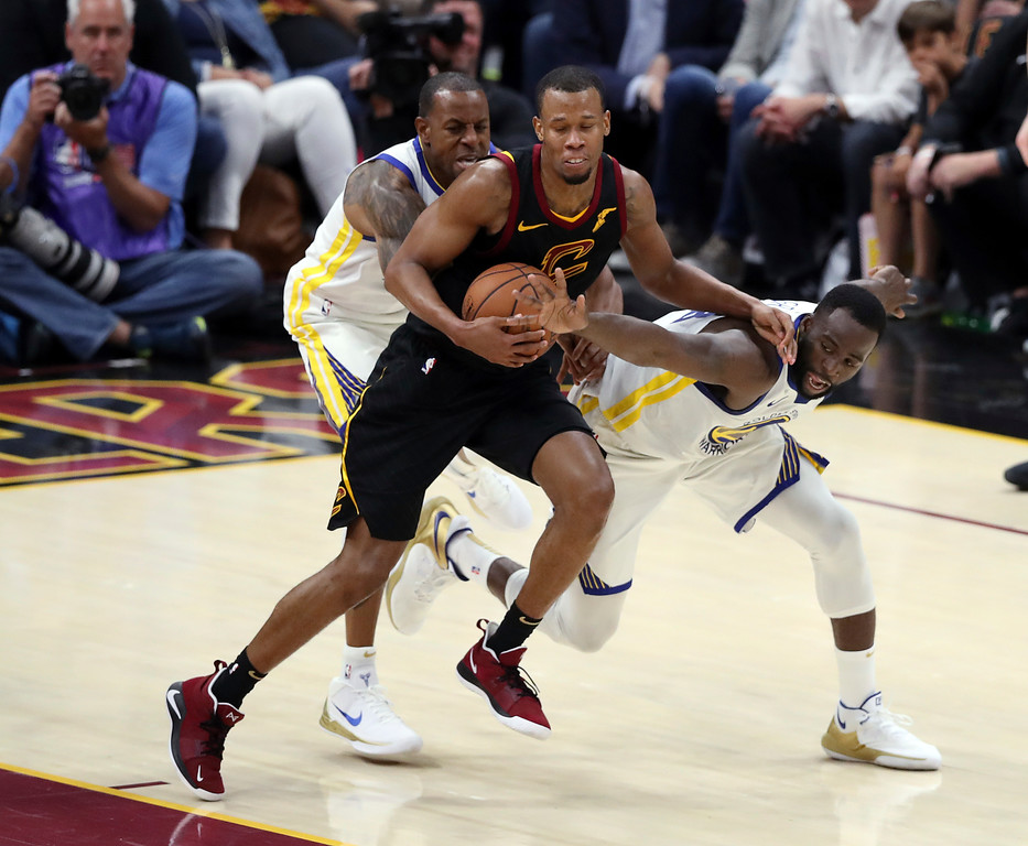 . Golden State Warriors forward Draymond Green, right, and forward Andre Iguodala defend Cleveland Cavaliers guard Rodney Hood (1) during the second half of Game 3 of basketball\'s NBA Finals, Wednesday, June 6, 2018, in Cleveland. The Warriors defeated the Cavaliers 110-102 to take a 3-0 lead in the series. (AP Photo/Carlos Osorio)
