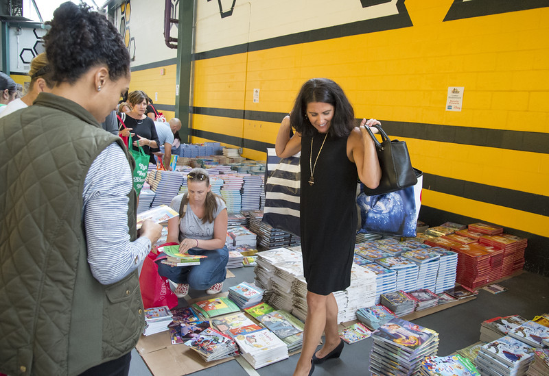 09/04/19  Wesley Bunnell | Staff  Twenty two thousand books were donated to area educators and parents with children by ESPN and Disney on Thursday September 4, 2019 at New Britain Stadium. Jennifer Shannon from Reggio Magnet School of the Arts carries two bags of books as she prepares to leave.