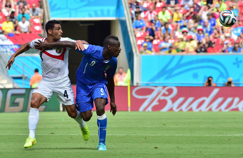 . Italy\'s forward Mario Balotelli (R) is challenged by Costa Rica\'s defender Michael Umana during a Group D match between Italy and Costa Rica at the Pernambuco Arena in Recife during the 2014 FIFA World Cup on June 20, 2014.  (GIUSEPPE CACACE/AFP/Getty Images)