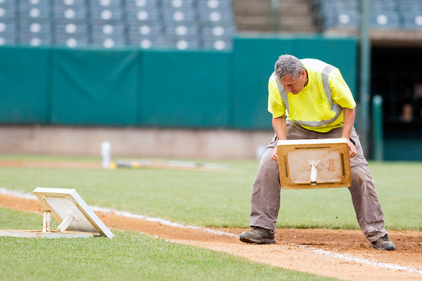 07/18/19 Wesley Bunnell | Staff The New Britain Bees vs the Southern Maryland Blue Crabs in a noon start double header on Thursday July 18, 2019. A grounds keeper changes the bases, which have been enlarged as part of experiment rules changes, between games.