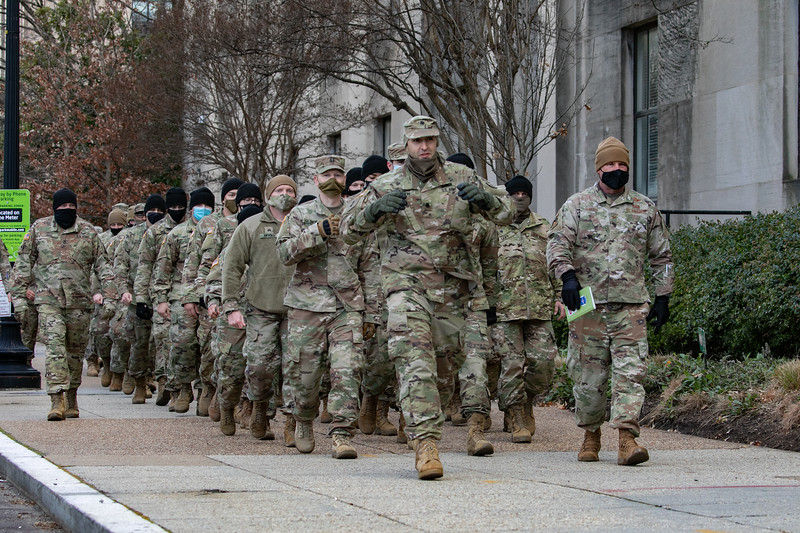 National Guard troops march towards the U.S. Capitol as the inauguration is set to begin