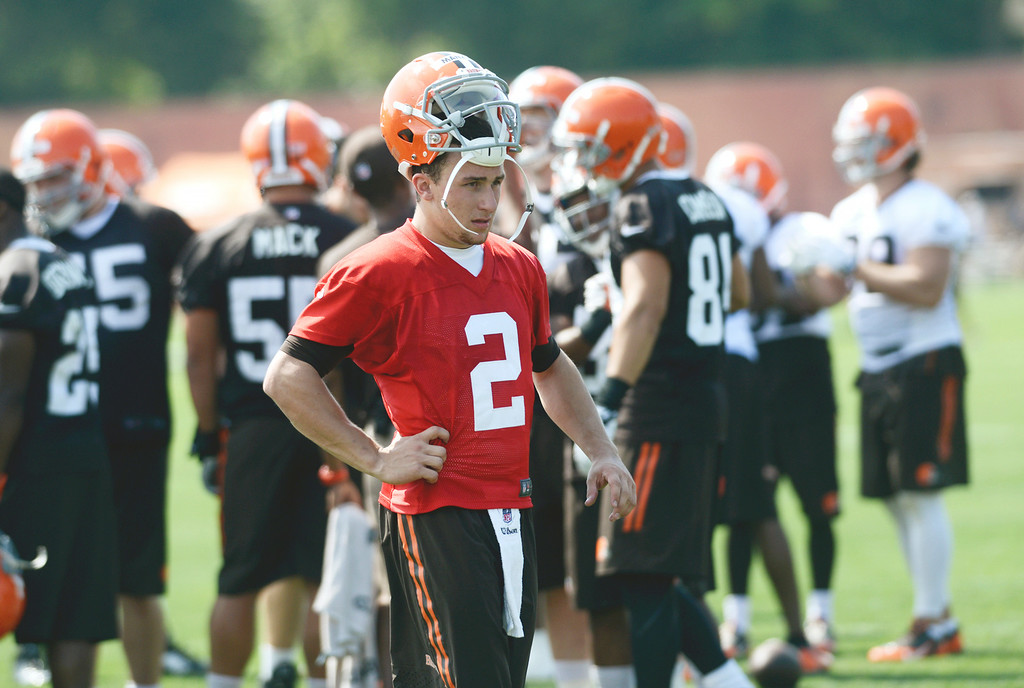 . Duncan Scott/DScott@News-Herald.com Johnny Manziel takes a break as the Cleveland Browns opened training camp on July 26 with their first practice at Browns headquarters in Berea.