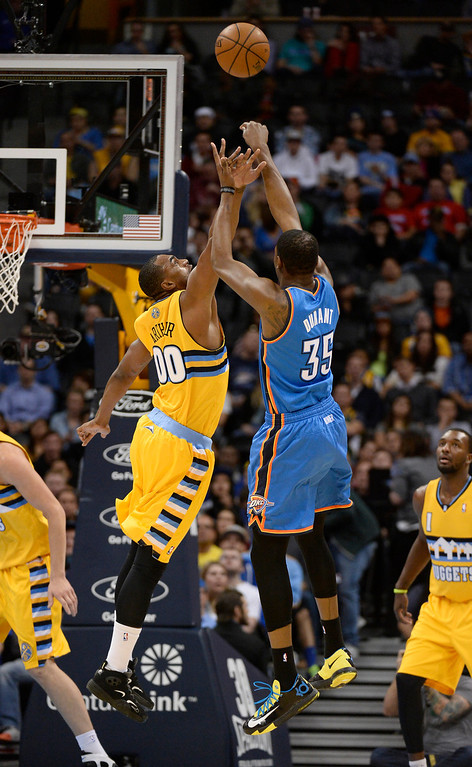 . Oklahoma City Thunder small forward Kevin Durant (35) takes a shot over Denver Nuggets power forward Darrell Arthur (00) during the first quarter December 17, 2013 at Pepsi Center. (Photo by John Leyba/The Denver Post)