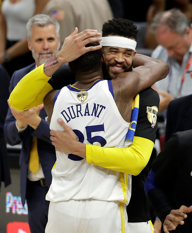. Golden State Warriors\' Kevin Durant and JaVale McGee celebrate following Game 4 of basketball\'s NBA Finals against the Cleveland Cavaliers, Friday, June 8, 2018, in Cleveland. The Warriors defeated the Cavaliers 108-85. (AP Photo/Tony Dejak)
