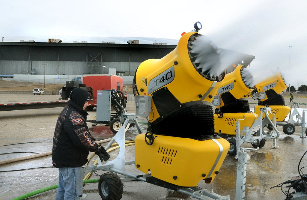 . ***WITH VIDEO*** Scott Sivula of ISOC Racing adjust the snow guns in the parking lot of the Pontiac Silverdome. They will truck the snow inside starting Thursday.  The Silverdome will be the home of this weekends the ISOC  AMSOIL Championship Snocross Series with opening ceremonies at 7 pm on Saturday.  Tickets start at $10.00.  The Oakland Press/TIM THOMPSON