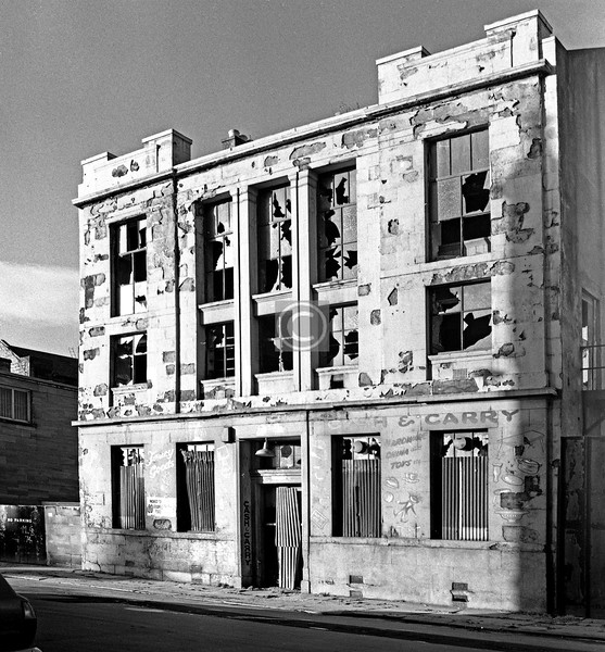 I have a date for this one, 6/12/75, but (how sloppy) no location. The preceding frame on the film was taken in Rutherglen Rd at Hospital St., and the following one is of the St Mungo's Halls in Ballater St. (both already posted), so the implication is that this very derelict building was somewhere in between, or at least in the general vicinity. The last occupiers were a fancy goods cash'n'carry which had moved to 20 Stockwell Place.