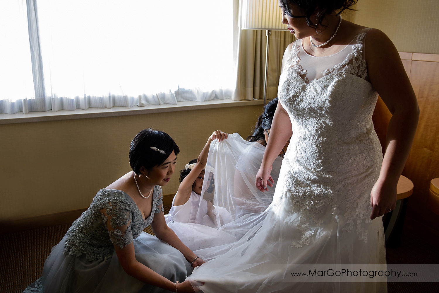 bride getting ready at Hilton San Francisco Airport Bayfront in Burlingame