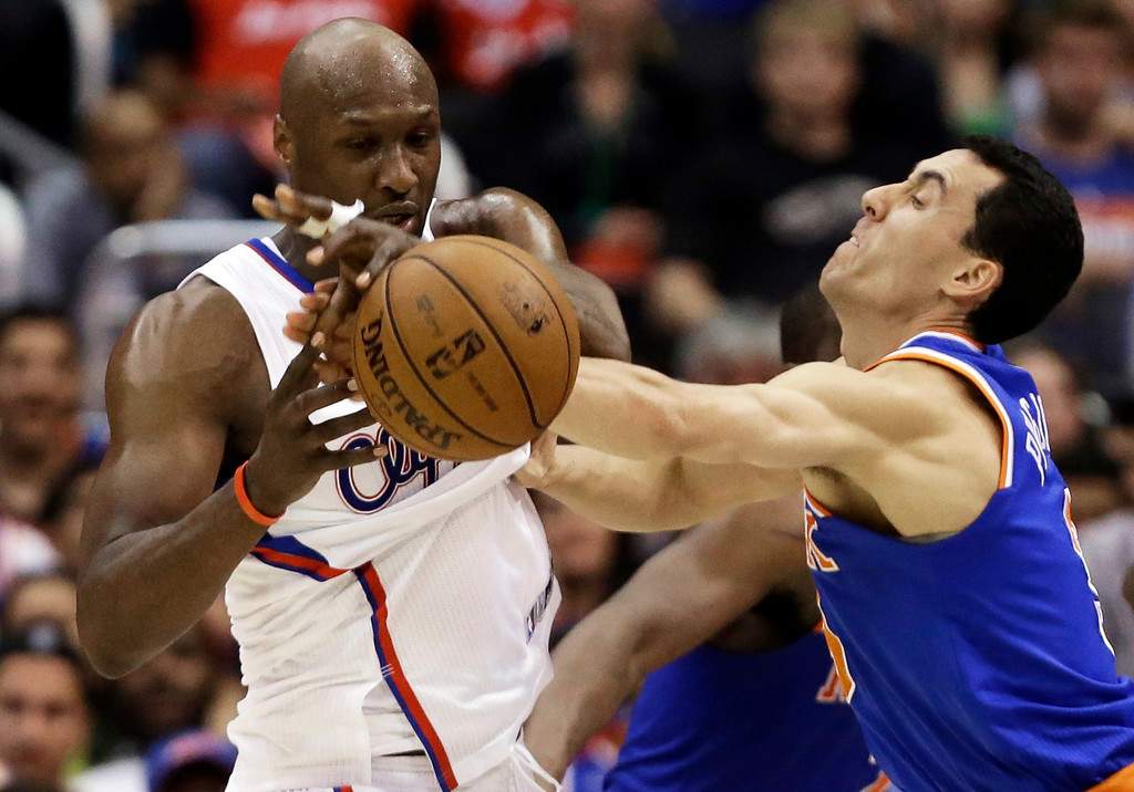 . New York Knicks guard Pablo Prigioni, right, of Argentina, fouls Los Angeles Clippers forward Lamar Odom (7) in the second half of an NBA basketball game in Los Angeles, Sunday, March 17, 2013.  (AP Photo/Reed Saxon)