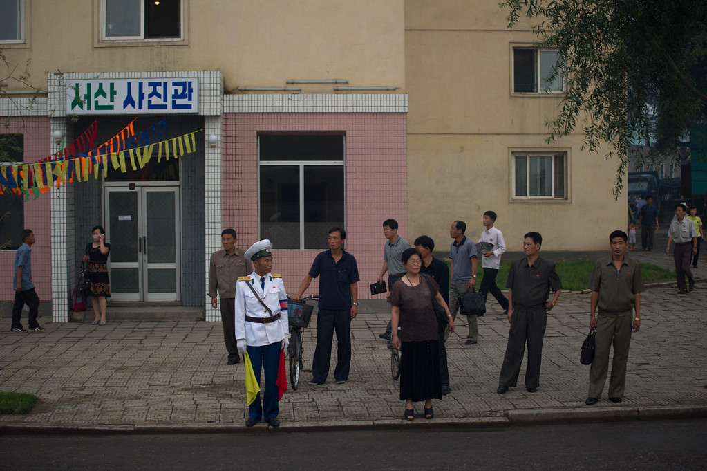 . Commuters wait at a bus stop in Pyongyang on July 25, 2013. North Korea is preparing to mark the 60th anniversary of the end of the Korean War which ran from 1950 to 1953, with a series of performances, festivals, and cultural events culminating with a large military parade taking place on July 27. AFP PHOTO / Ed JonesEd Jones/AFP/Getty Images