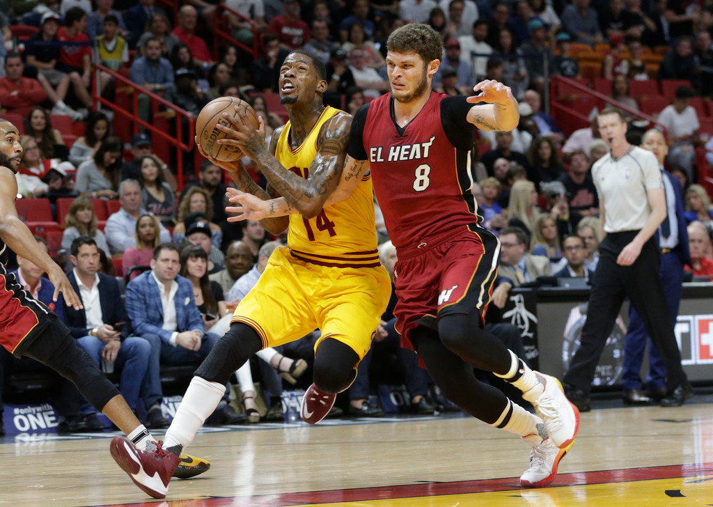 . Cleveland Cavaliers\' DeAndre Liggins (14) drives to the basket as Miami Heat\'s Tyler Johnson (8) defends during the first half of an NBA basketball game, Saturday, March 4, 2017, in Miami. (AP Photo/Lynne Sladky)