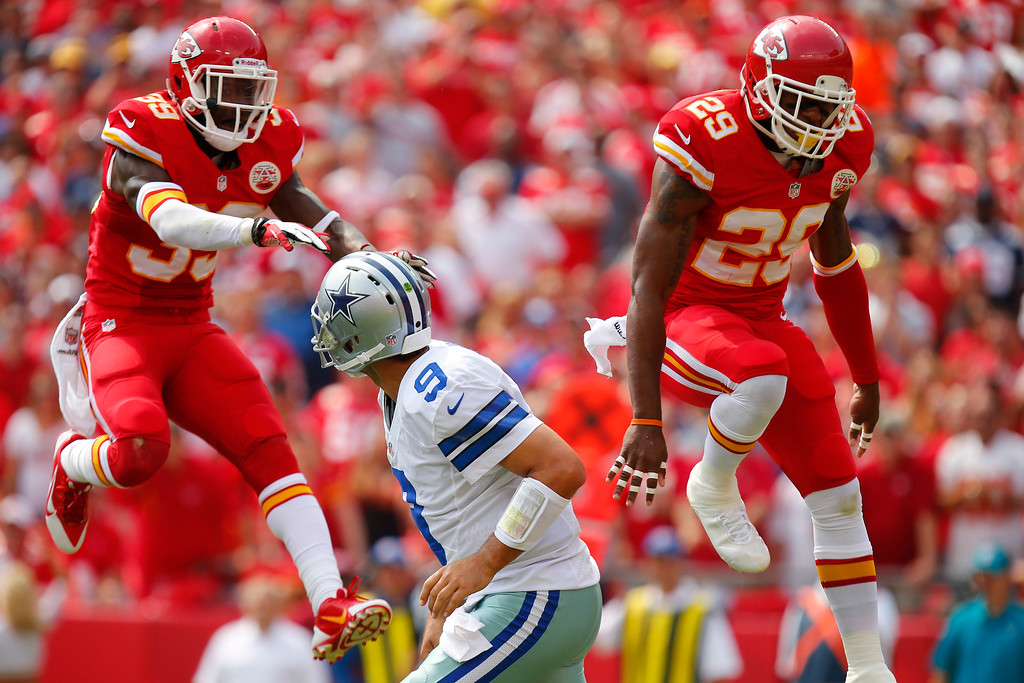 . Husain Abdullah #39 and Eric Berry #29 of the Kansas City Chiefs attempt to knock down the pass from Tony Romo #9 of the Dallas Cowboys in the second quarter September 15, 2013 at Arrowhead Stadium in Kansas City, Missouri. (Photo by Kyle Rivas/Getty Images)