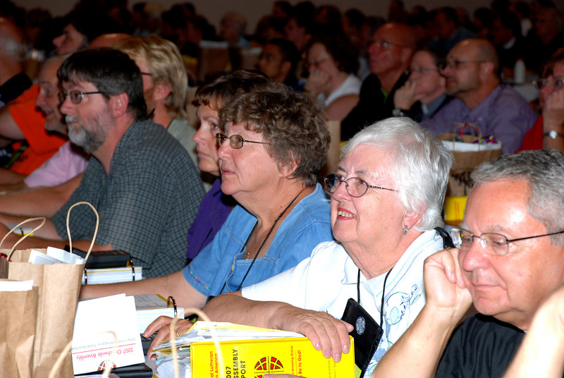 Voting Members listening to Bishop Hanson.