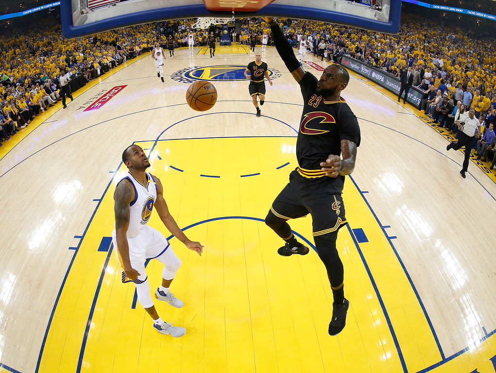 . Cleveland Cavaliers forward LeBron James (23) dunks against Golden State Warriors forward Andre Iguodala during the first half of Game 2 of basketball\'s NBA Finals in Oakland, Calif., Sunday, June 4, 2017. (John G. Mabanglo/Pool Photo via AP)