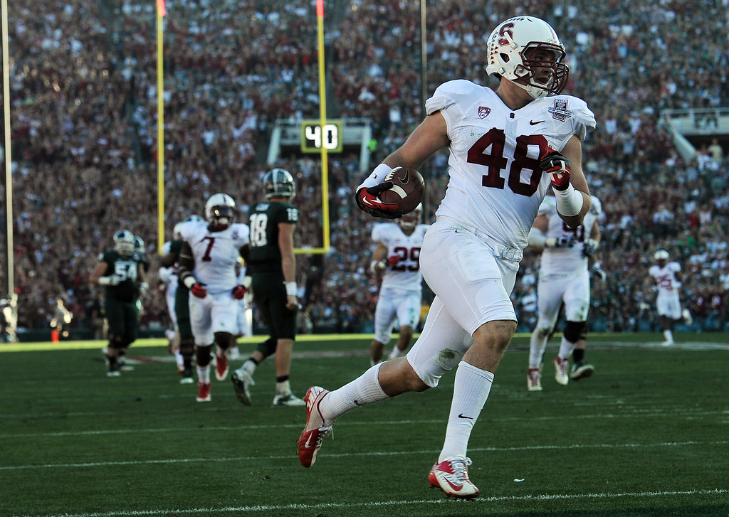 . Stanford\'s Kevin Anderson #48 runs in to the end zone after intercepting a pass in the 2nd quarter against Michigan State during the 100th Rose Bowl game in Pasadena Wednesday, January 1, 2014. (Photo by Hans Gutknecht/Los Angeles Daily News)